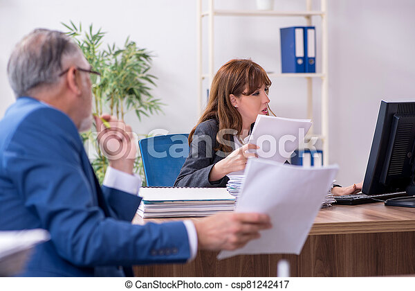 Two employees working in the office - csp81242417