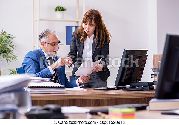 Two employees working in the office - csp81520918