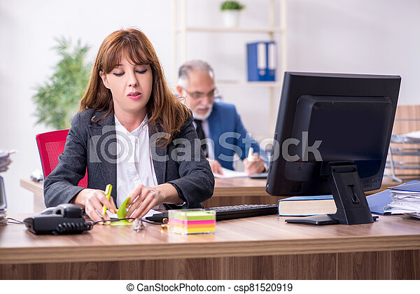 Two employees working in the office - csp81520919