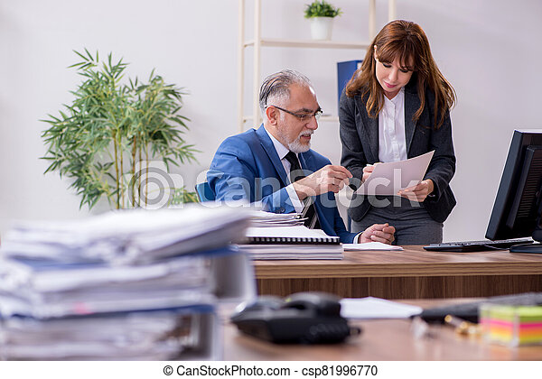 Two employees working in the office - csp81996770