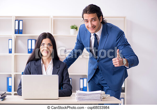 Two employees working in the office - csp68033984