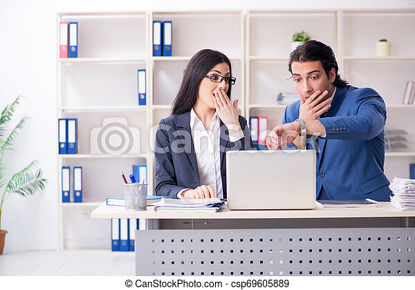 Two employees working in the office - csp69605889