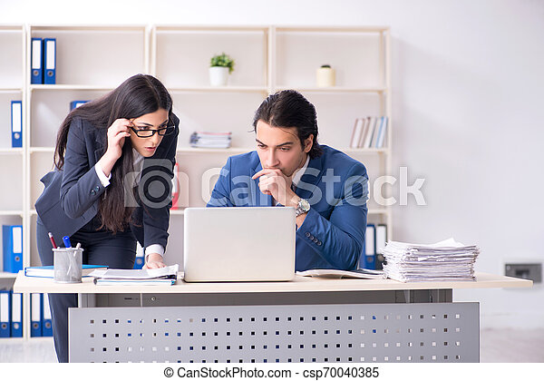 Two employees working in the office - csp70040385
