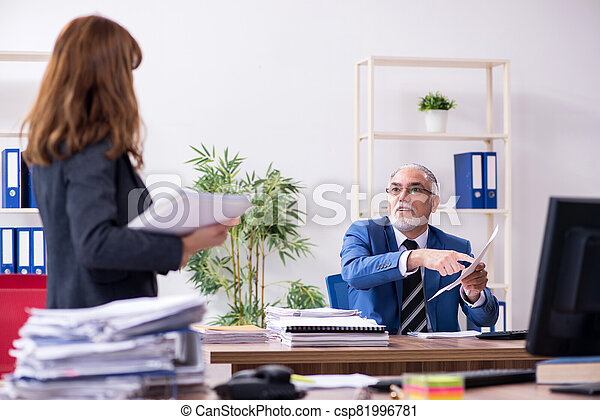 Two employees working in the office - csp81996781