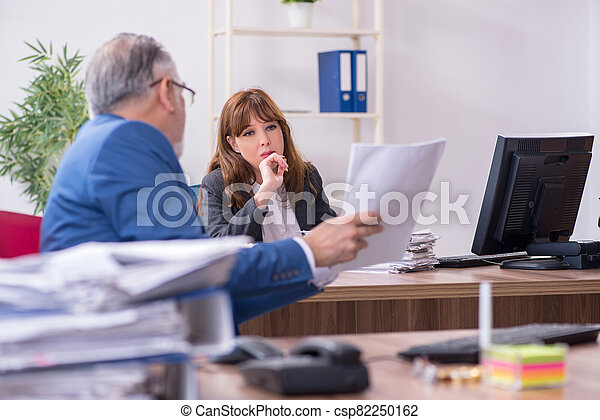 Two employees working in the office - csp82250162