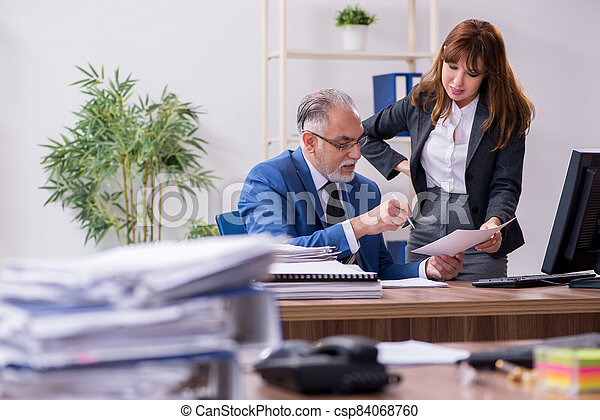 Two employees working in the office - csp84068760
