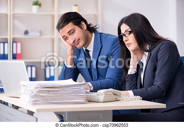 Two employees working in the office - csp70962553