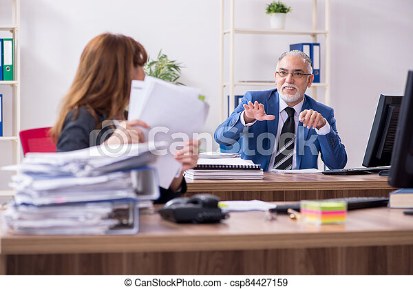 Two employees working in the office - csp84427159