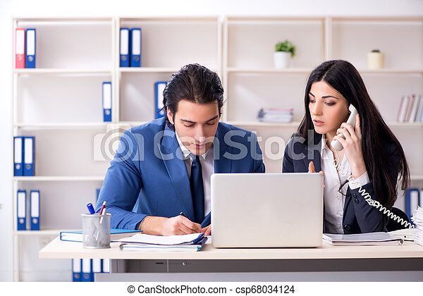 Two employees working in the office - csp68034124