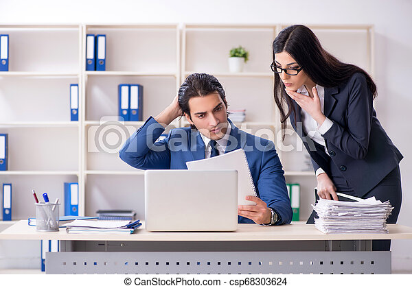 Two employees working in the office - csp68303624
