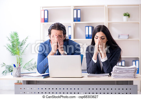 Two employees working in the office - csp68303627