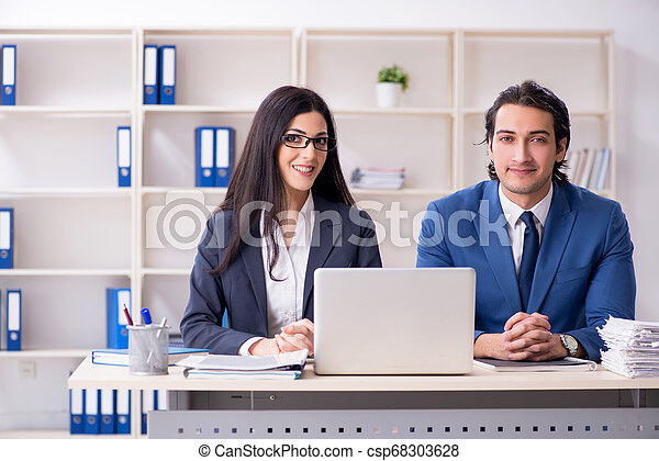 Two employees working in the office - csp68303628