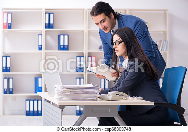 Two employees working in the office - csp68303748