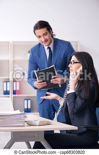 Two employees working in the office - csp68303820