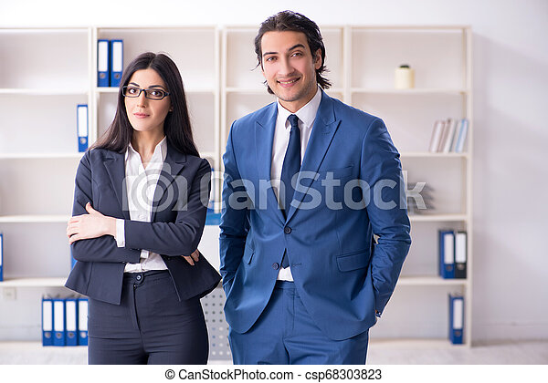 Two employees working in the office - csp68303823