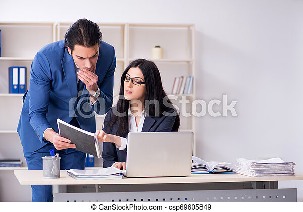 Two employees working in the office - csp69605849