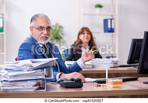 Two employees working in the office - csp81520927
