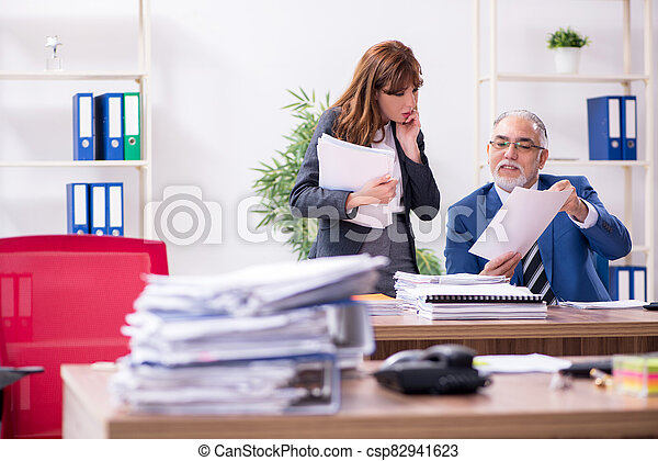 Two employees working in the office - csp82941623