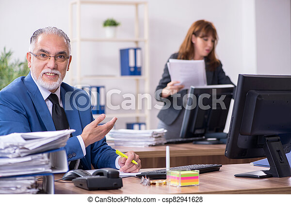 Two employees working in the office - csp82941628