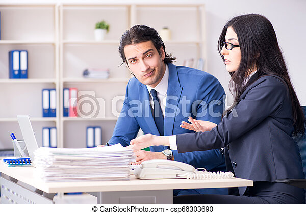 Two employees working in the office - csp68303690