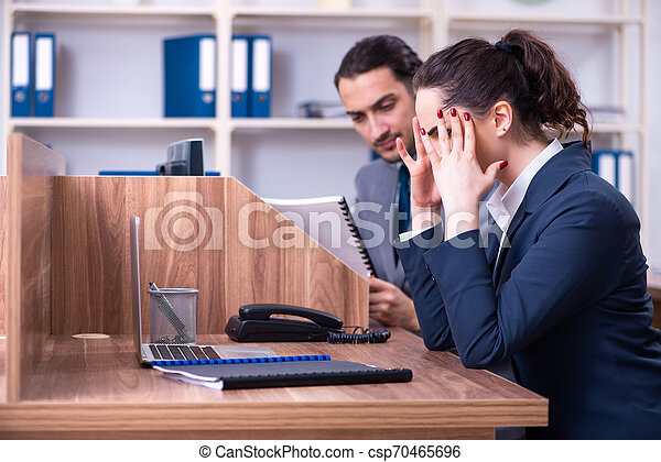 Two employees working in the office - csp70465696