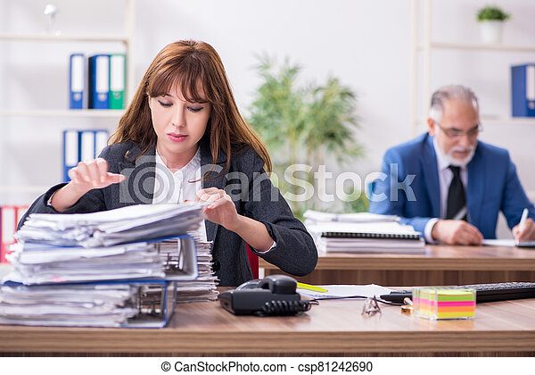 Two employees working in the office - csp81242690