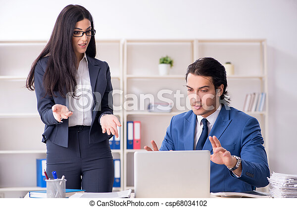 Two employees working in the office - csp68034102