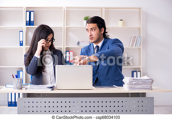 Two employees working in the office - csp68034103
