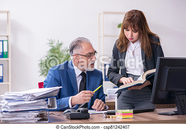 Two employees working in the office - csp81242407