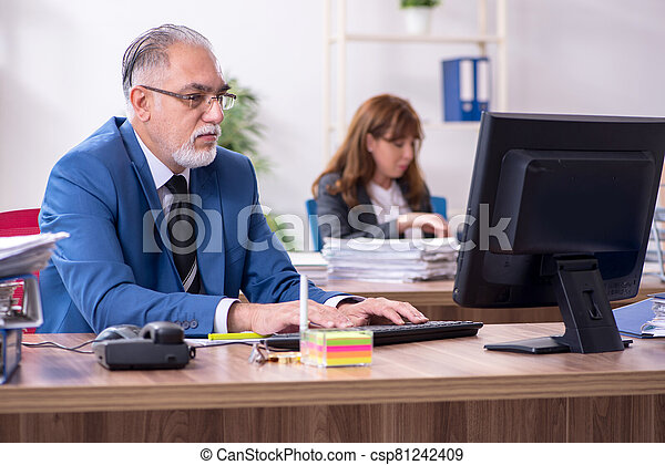 Two employees working in the office - csp81242409