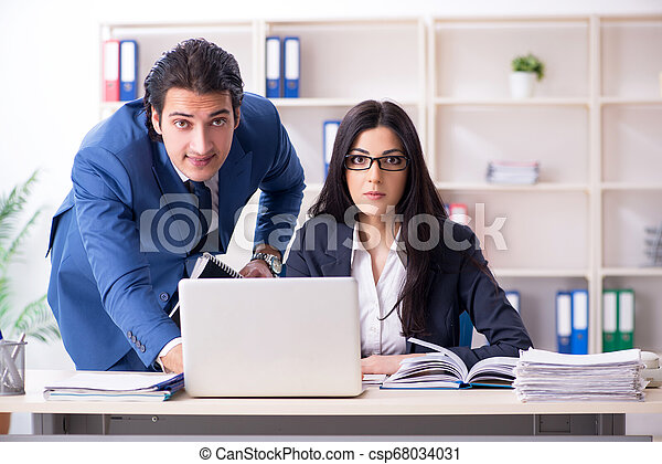 Two employees working in the office - csp68034031