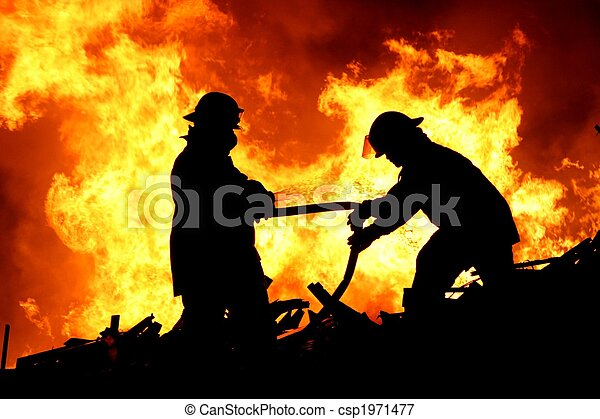 Two fire fighters and flames - csp1971477