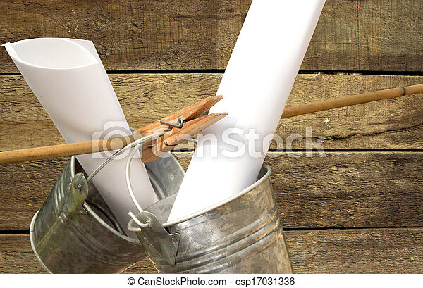 two galvanized buckets pegged on bamboo stick with wooden slatted background - csp17031336
