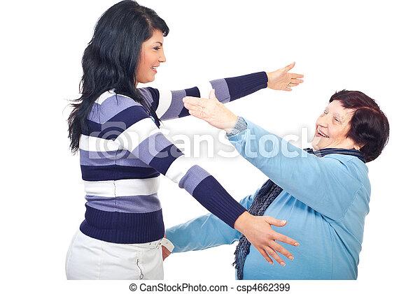 Two  generations of women prepare to hug - csp4662399