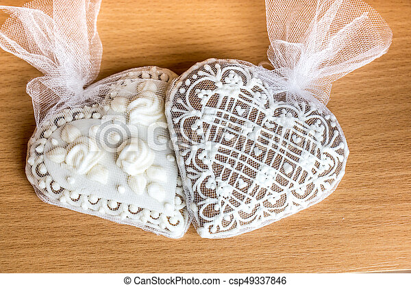 Two Gingerbread Heart Cookies On Wooden Table