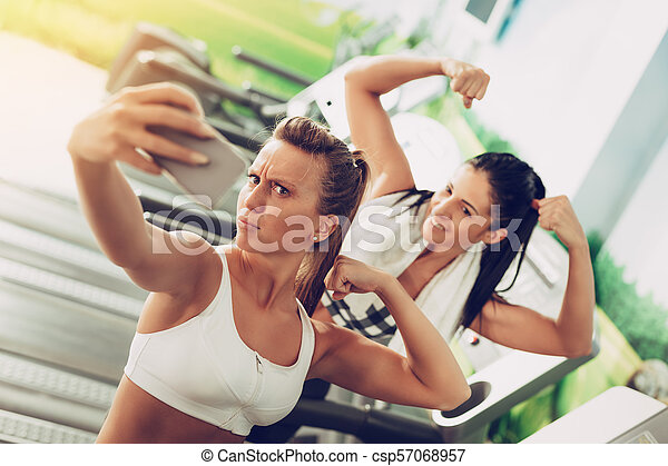 Two Girl Having Fun At The Gym Funny Female Friends Taking Selfie After Workout On The Beach