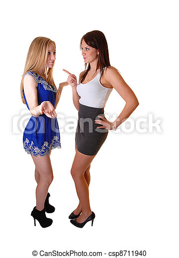 Two Girls Arguing Beautiful Young Woman Standing In The Studio