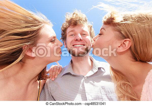 adult women kissing