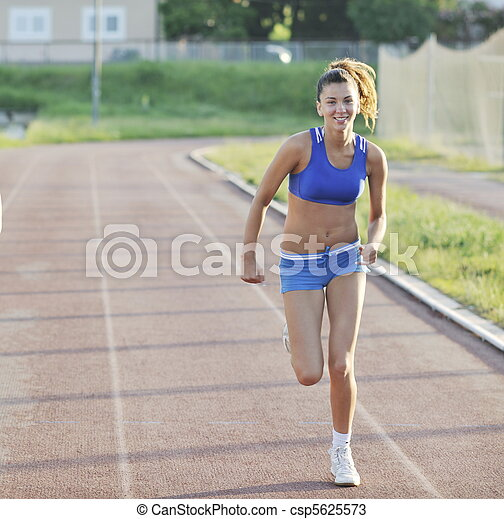 Two girls running on athletic race track. Young girl morning run and  competition on athletic race track. | CanStock