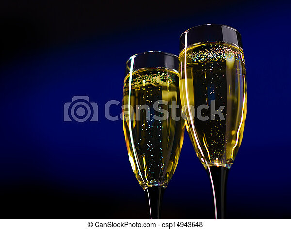 Two Glasses of Champagne on Dark Blue Background - csp14943648