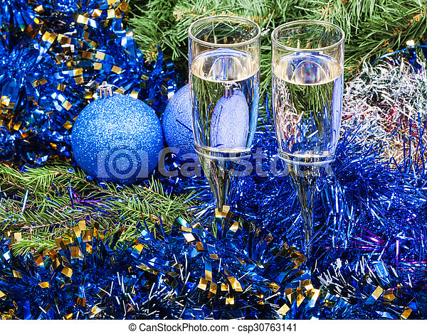 Two glasses with blue Xmas decorations and tree 7 - csp30763141