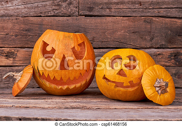 Two Halloween Pumpkins On Wooden Background Scary And Funny