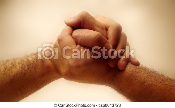 two hands grabbing each other