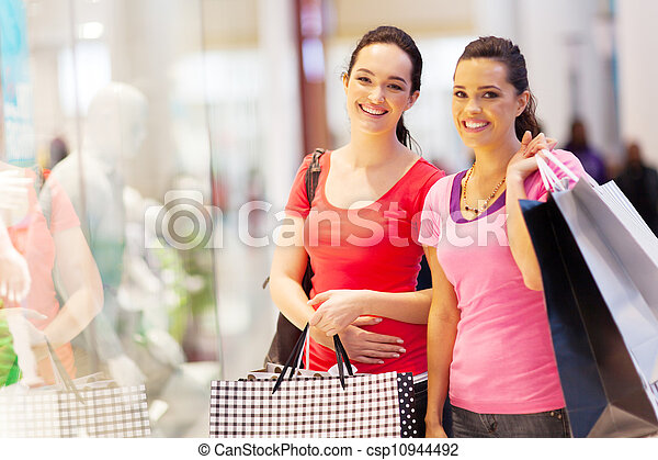 two happy friends shopping in mall - csp10944492