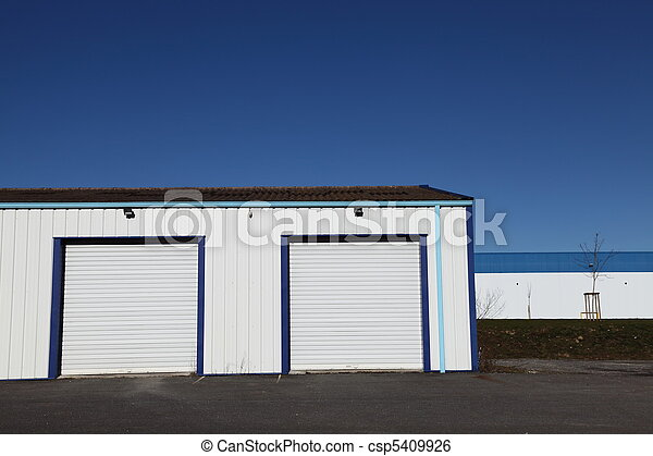 Two Industrial Garage Doors Two Closed White Corrugated Industrial