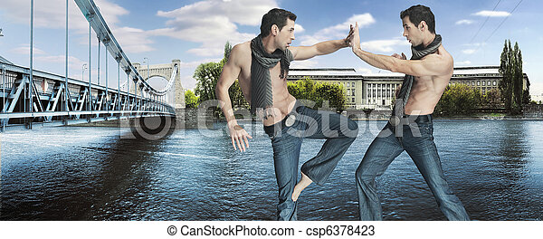 Two karate fighters kicking on the riverside - csp6378423