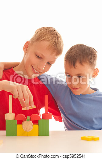Two kids playin with brick-sat - csp5952541