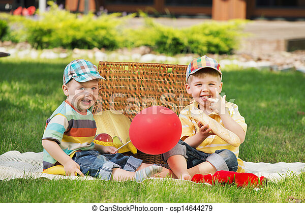 Two little brothers playing on the blanket - csp14644279