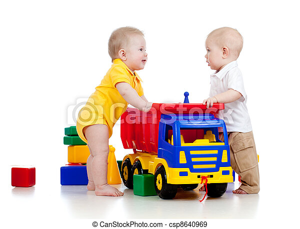 two little children playing with color toys - csp8640969