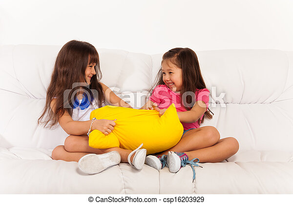 Two Little Girls Fighting Over Pillow Stock Photo